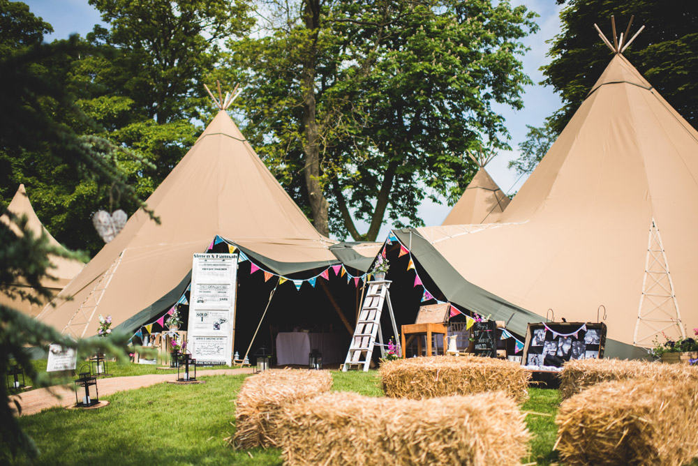 Three Giant Hat Tipis for a relaxed garden wedding by Sami Tipi. Captured by Martin Makowski