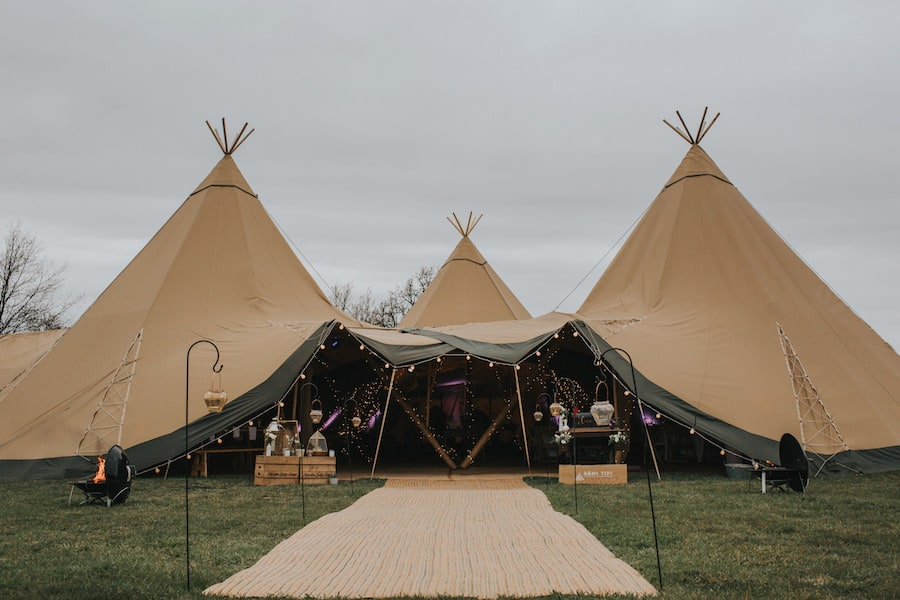 Three giant hat tipi entrance - Sami Tipi Showcase captured by Ed Brown Photography