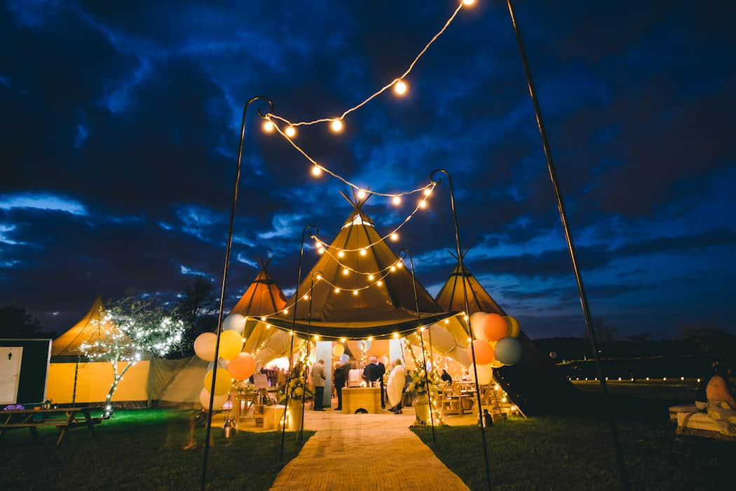 Tipis at Night - Sami Tipi Wedding at Bawdon Lodge Farm captured by Matt Brown Photography