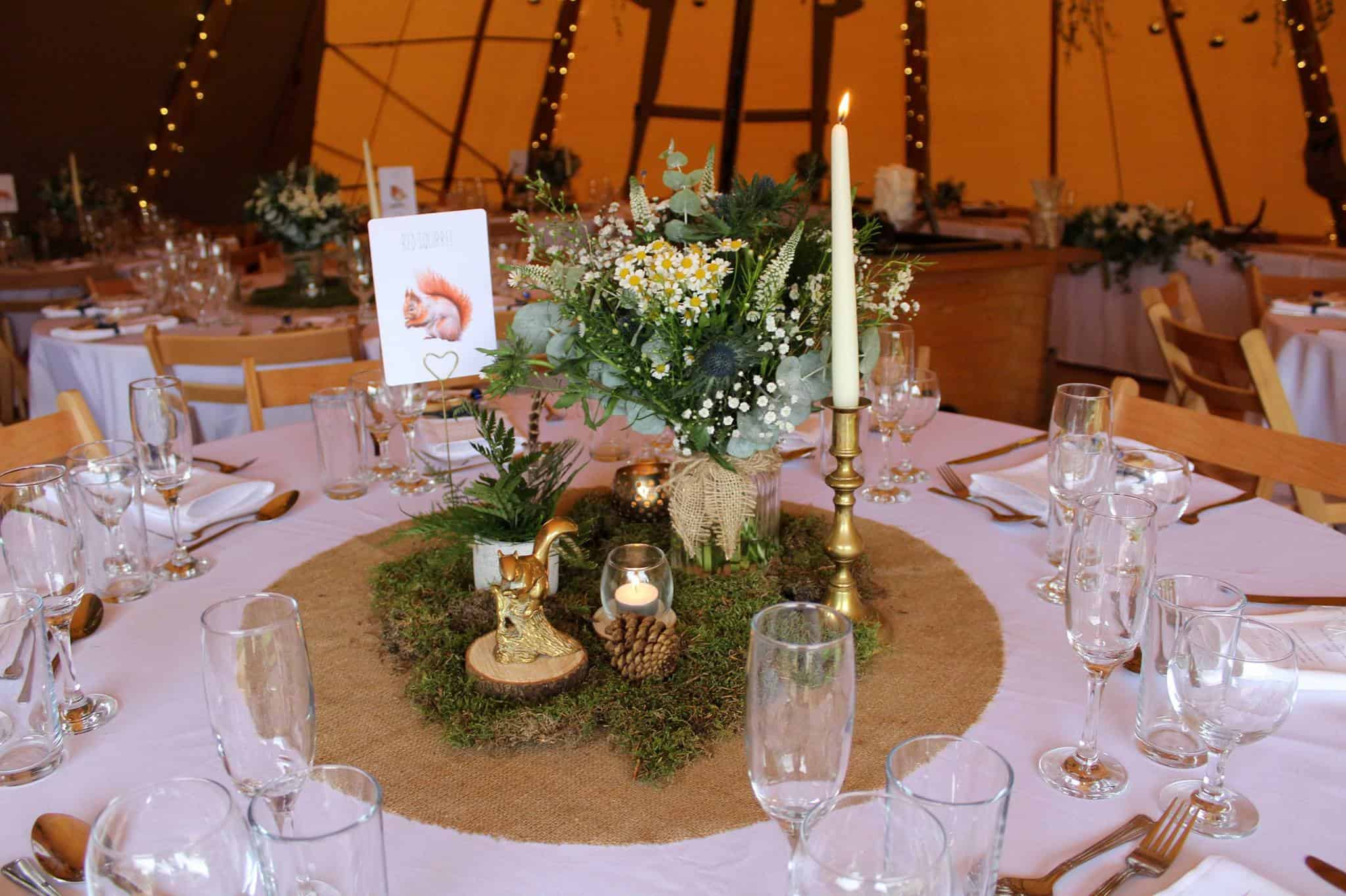 Squiral table - Woodland themed styling by The Rustic Wedding Company