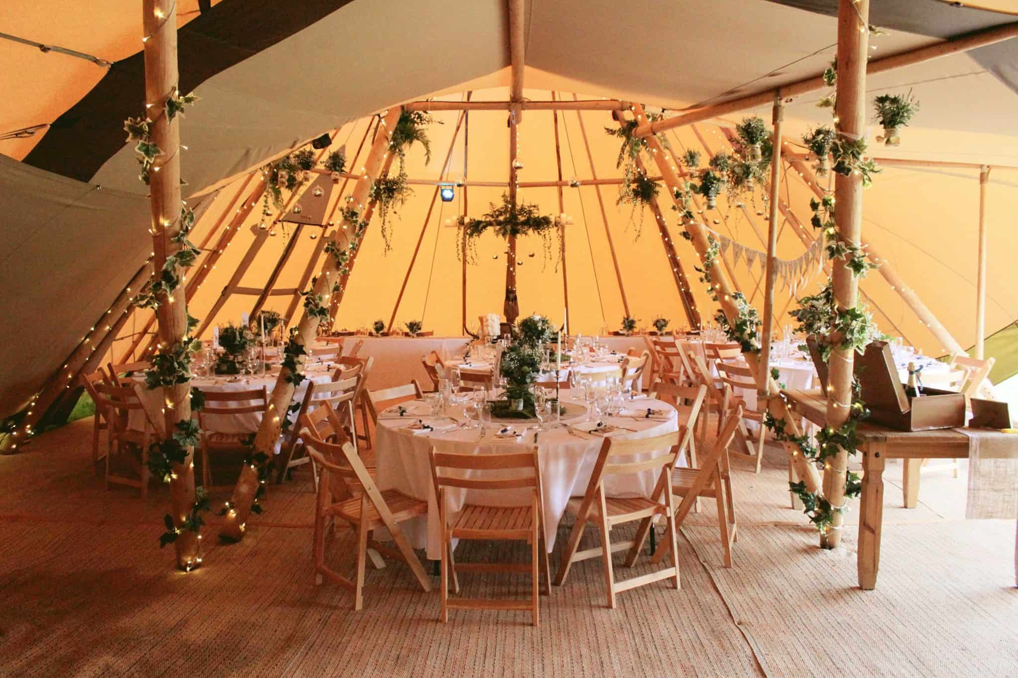 Tipi Seating with round tables - Woodland themed styling by The Rustic Wedding Company