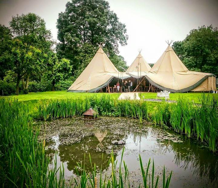 three-giant-hat-tipis-in-a-triangle-with-side-extension