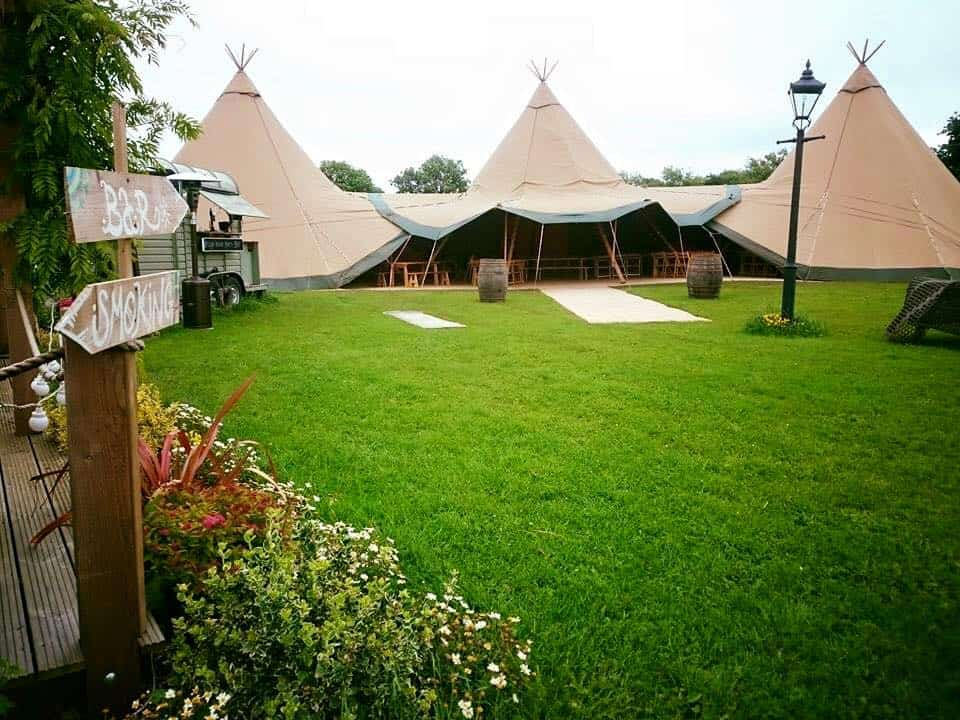 three-giant-hat-tipis-in-an-arc-by-sami-tipi