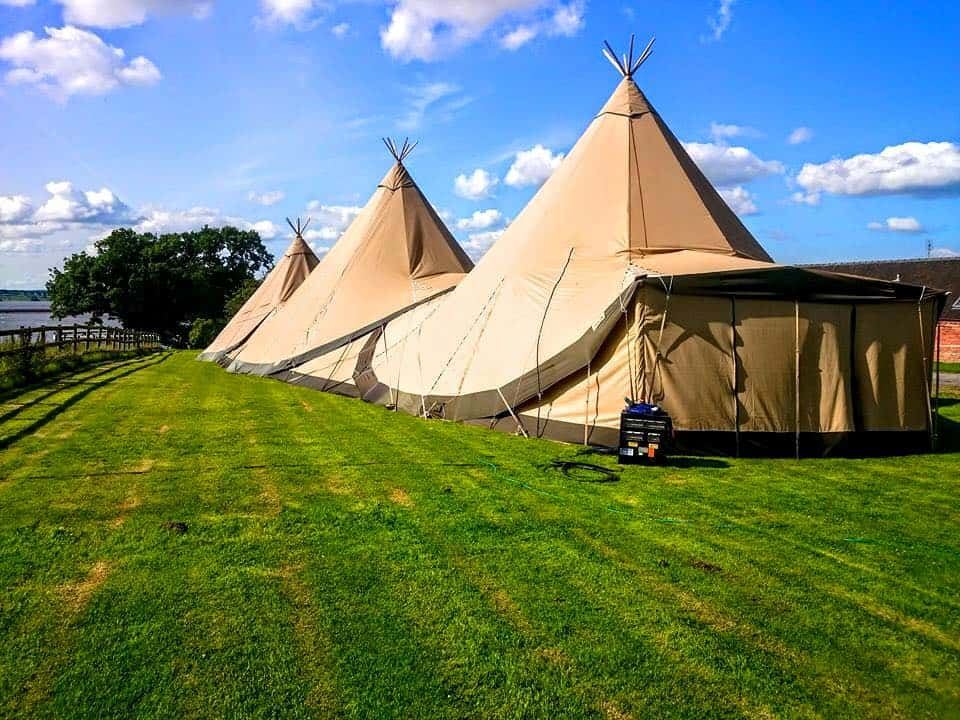 two-giant-hat-tipis-and-chill-out-tipi-with-side-extension