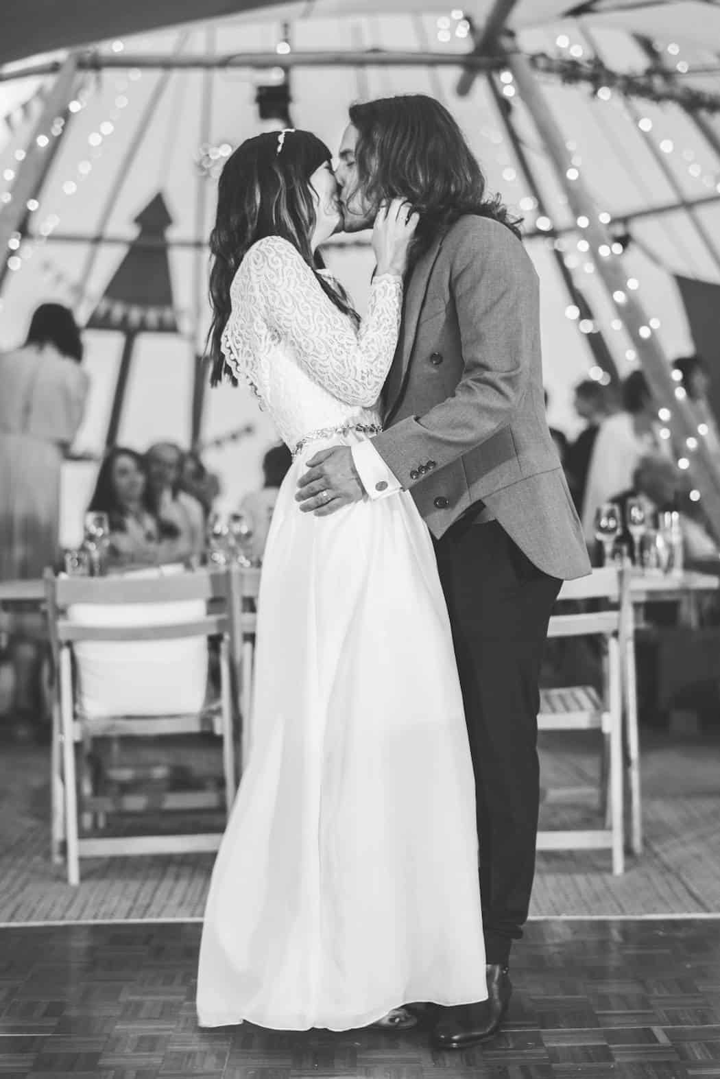 First Kiss - Victoria & Adams Sami Tipi Wedding at Bawdon Lodge Farm, Captured by Thomas & Thomas