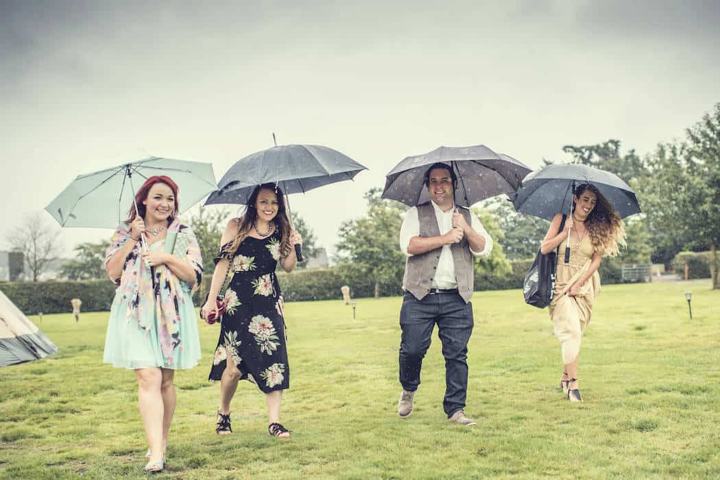 Embracing the great British weather - Victoria & Adams Sami Tipi Wedding at Bawdon Lodge Farm, Captured by Thomas & Thomas