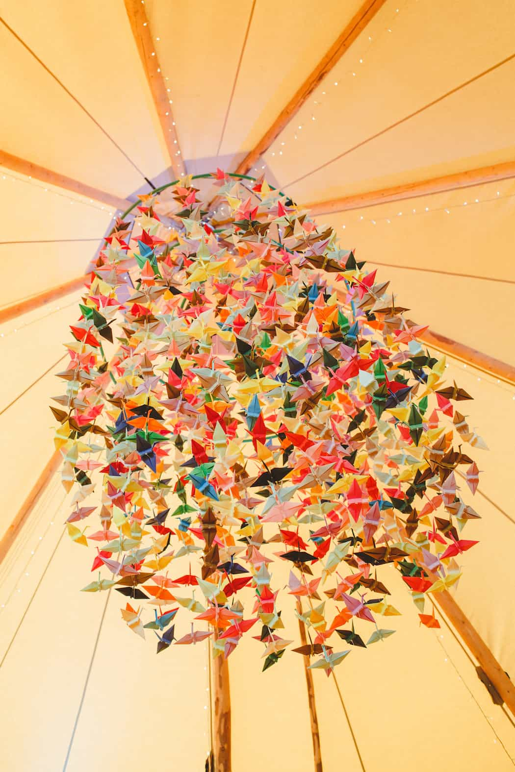 1000 Origami paper cranes hanging in tipi