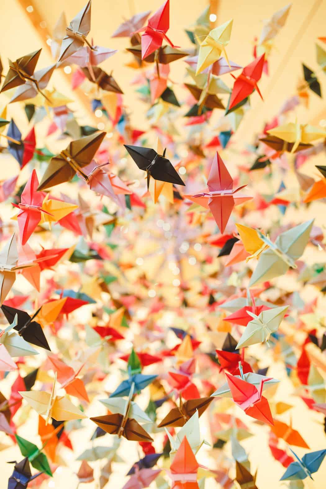 1000 DIY Origami paper cranes hanging in tipi