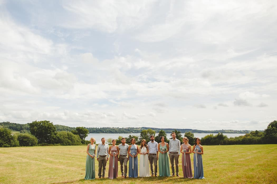 Bridal party at Shiningford Manor in front of Carsington Water