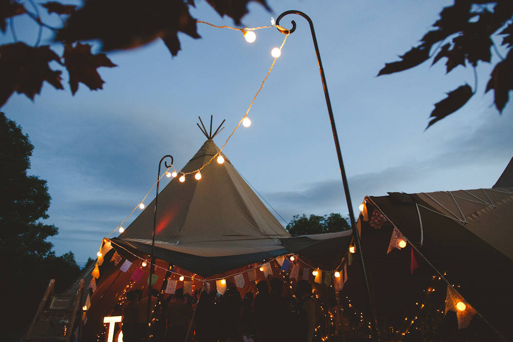 Tipis at dusk Tom and Ellie's Sami Tipi Wedding at Shingford Manor Derbyshire captured by Camera Hannah