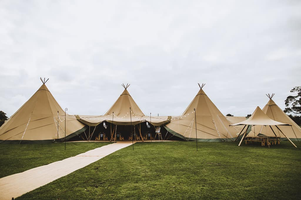 Three giant hat tipis witch chill-out tipi and little hat - Sami Tipi Wedding Hire
