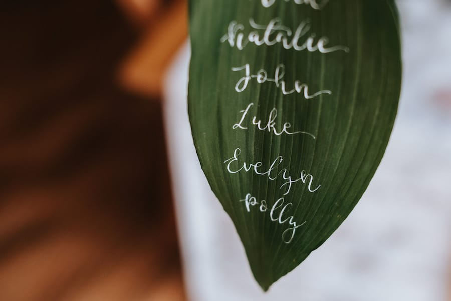Tropical Leaf Seating Plan| Hand Lettering by Polly & Me | Sami Tipi| Styled by Tickety Boo Events | Image by Ed Brown Photography