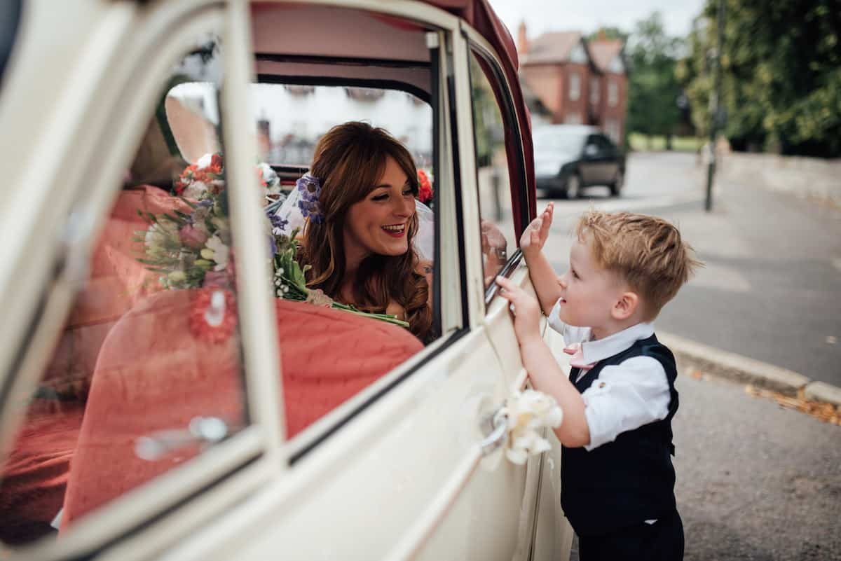 Entertaining children at weddings. Son greeting Mum on arrival to church