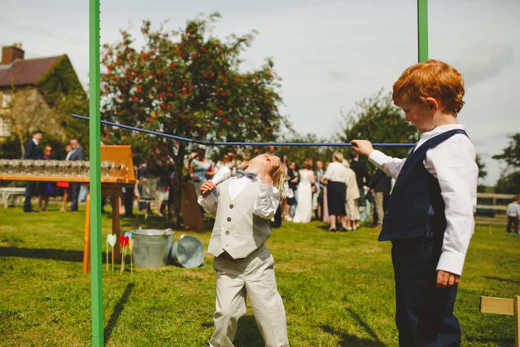 Entertaining children at weddings with outdoor games - limbo