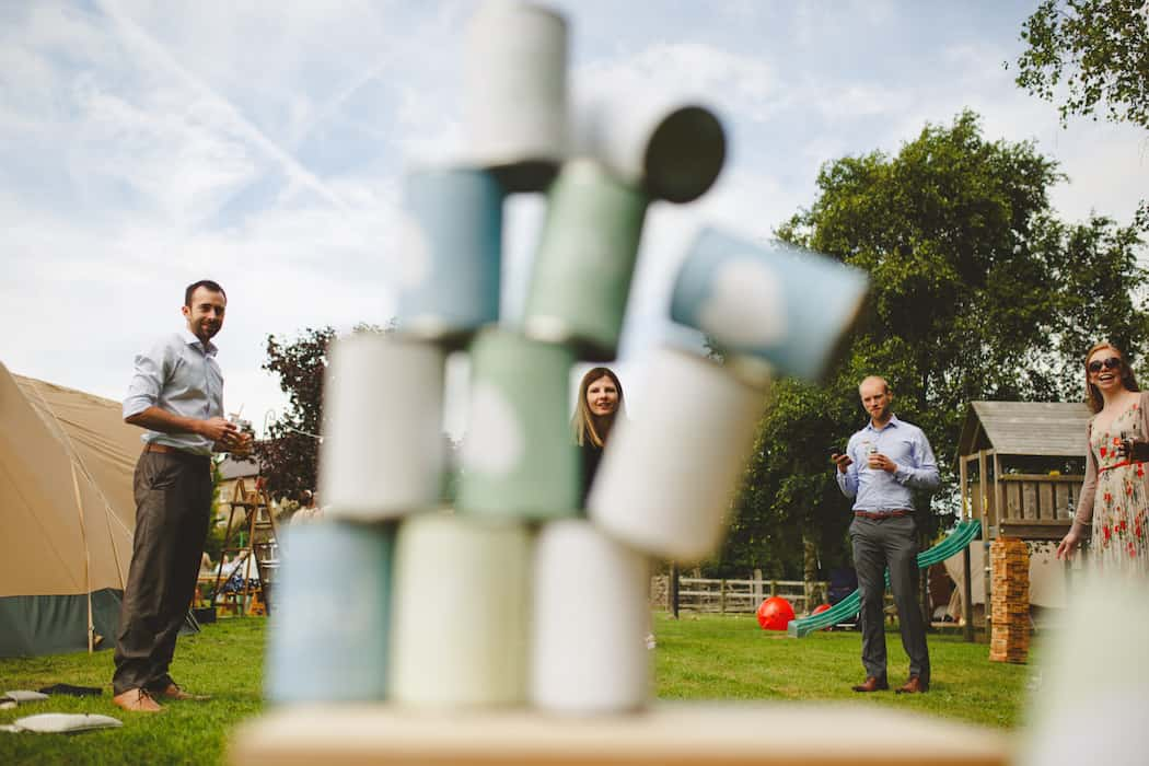Entertaining children at weddings with outdoor games - diy tin can alley