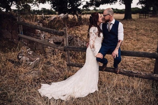 Bride and Groom making the most of the farm surrounding Cuttle Brook