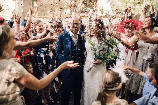 Confetti throwing over bride and groom