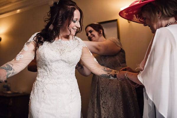 Bride getting ready in her lace dress