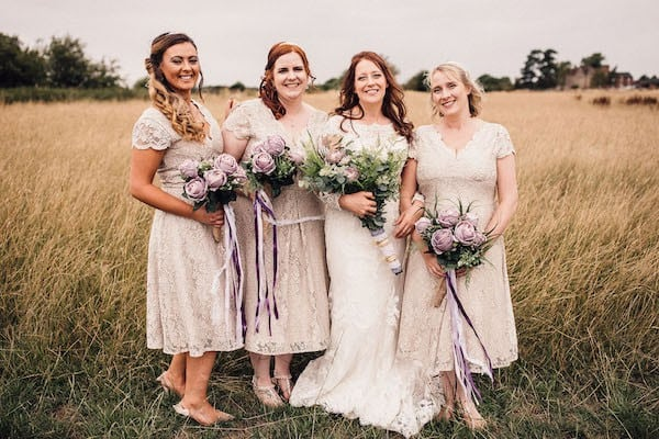 Bride and Bridesmaids with artificial flower bouquet at Cuttle Brook
