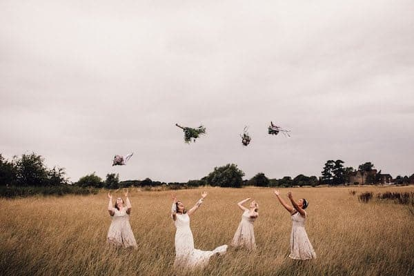 Bride and Bridesmaids throwing artificial flower bouquet at Cuttle Brook