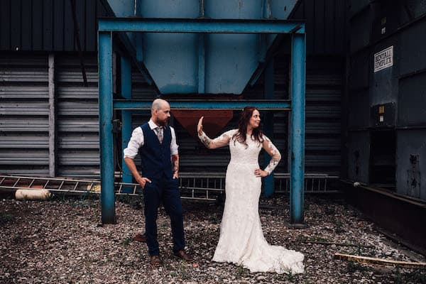 Industrial machinery at Cuttle Brook. Bride and groom making the most of the space and freedom
