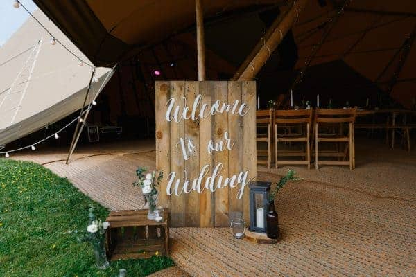 welcome to our wedding sign at tipi entrace