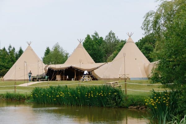 three giant hat tipis at lakeside venue in derbyshire