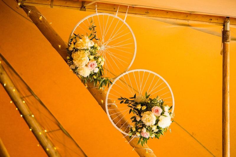 Hanging floral decoration in tipi wedding