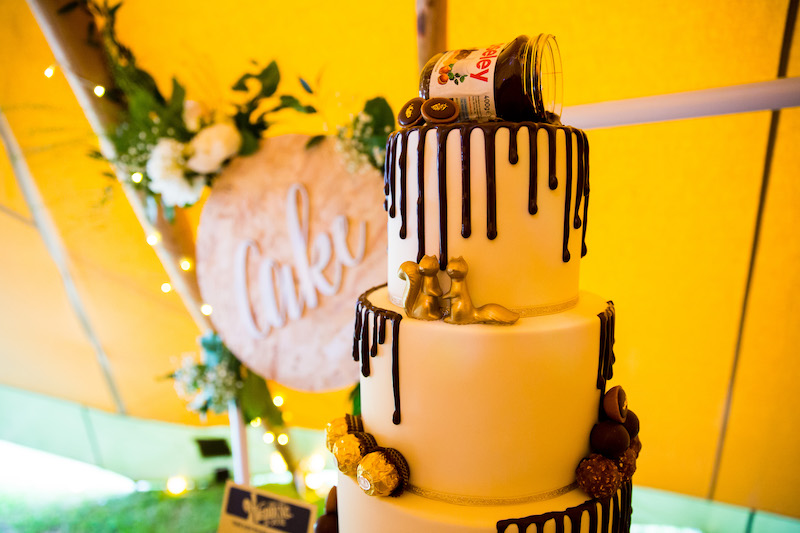 Drizzled chocolate wedding cake with personalised topper