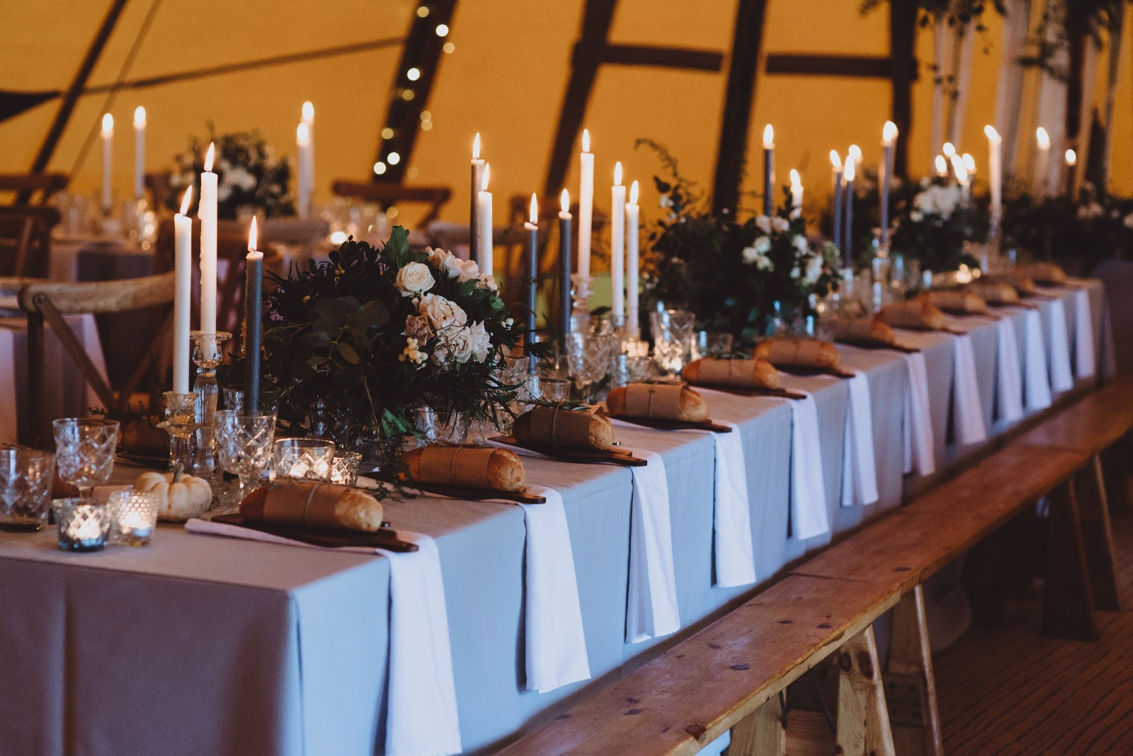 How To Style Your Tipi Wedding Explained by Lesley of The Rustic Wedding Company. Simple blue cloths, draped napkins and french bread was the baseline for this look.