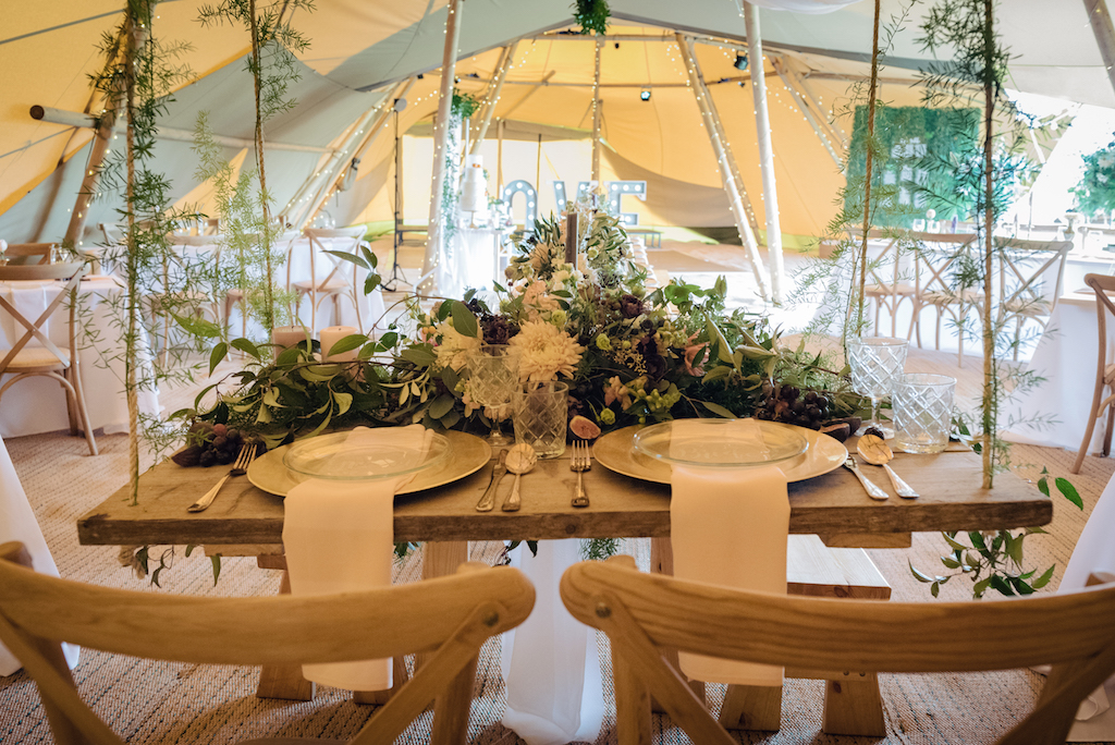 Tipi Styling with swing top table and lots of greenery