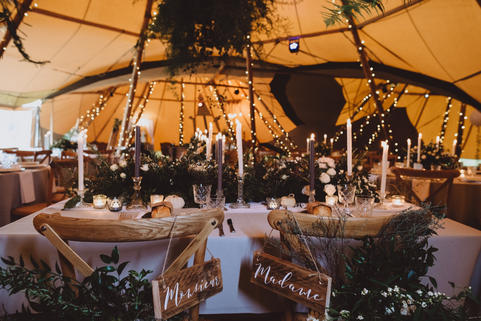 How To Style Your Tipi Wedding Explained by Lesley of The Rustic Wedding Company. Over Sized Greenery both hanging and on chairs