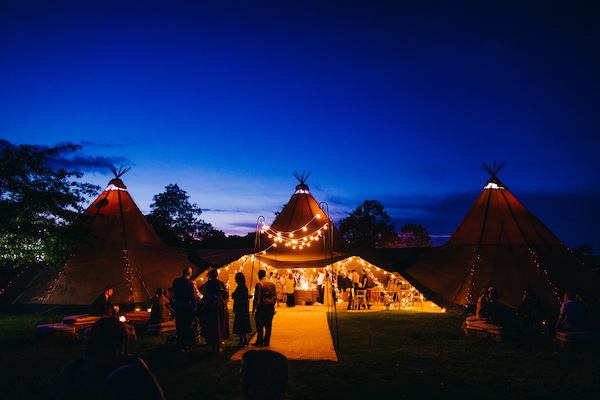 Three Giant Hat Tipis at night at Bawdon Lodge Farm