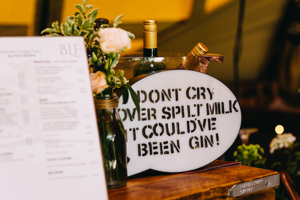 Don't cry over spilt milk it could've been gin sign