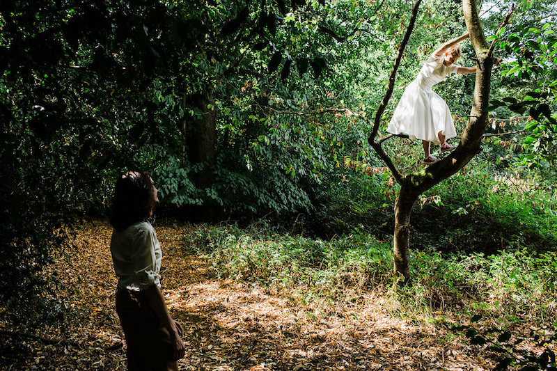 Nanpantan Tipi Wedding, bride climbing tree