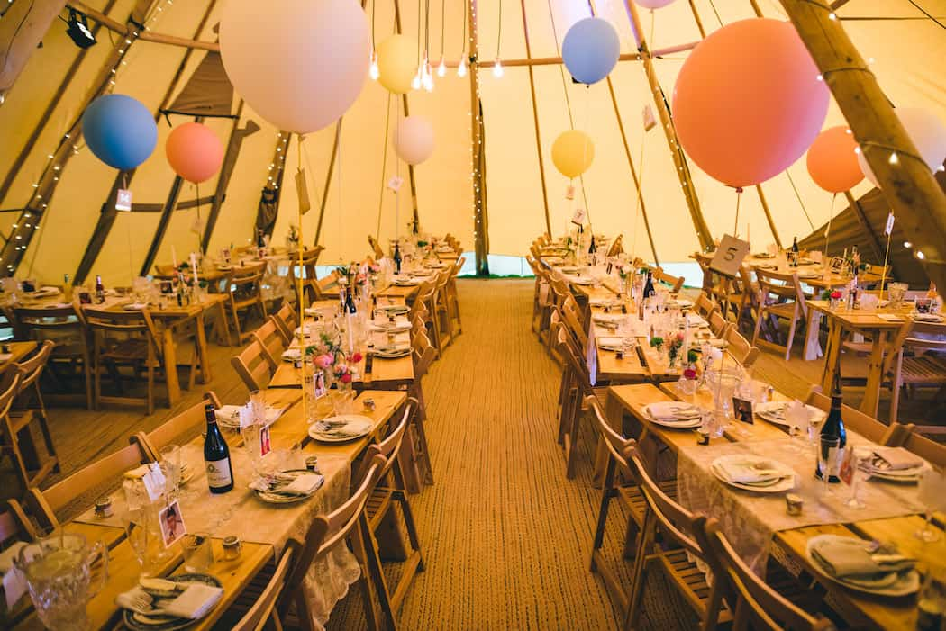 table setup for Bawdon Lodge Farm Tipi Wedding in three giant hat teepees