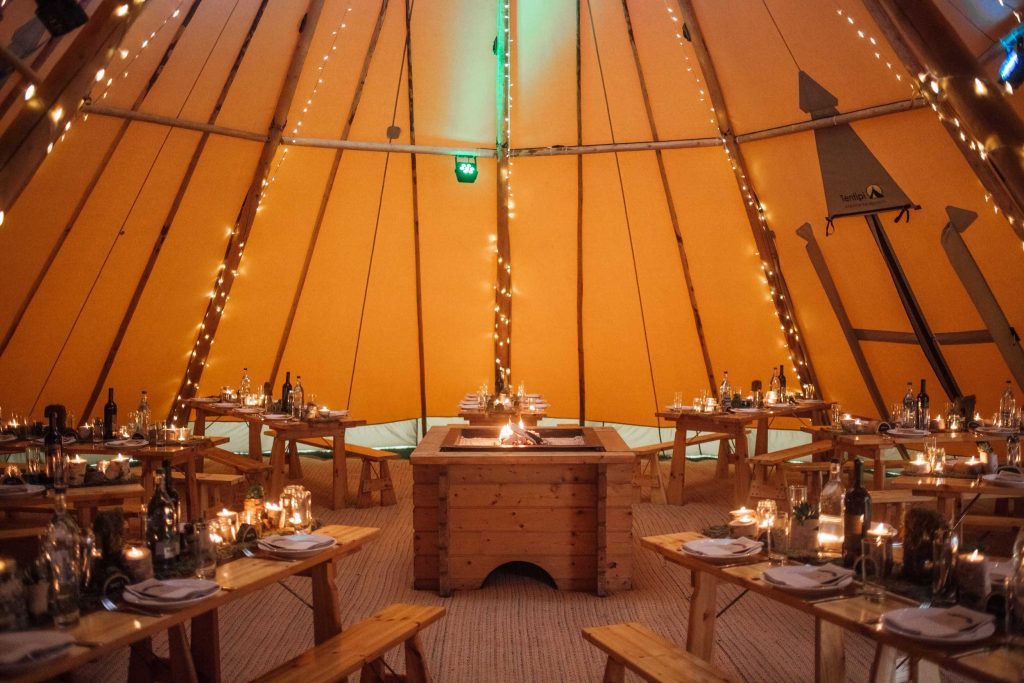 21st Birthday celebration in two giant hat tipis. Tipi tables spoked around open fire place