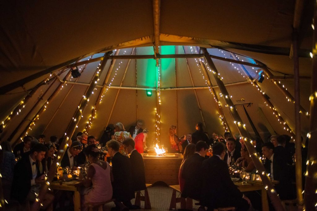 21st Birthday meal under the atmospheric canvas of a tipi party