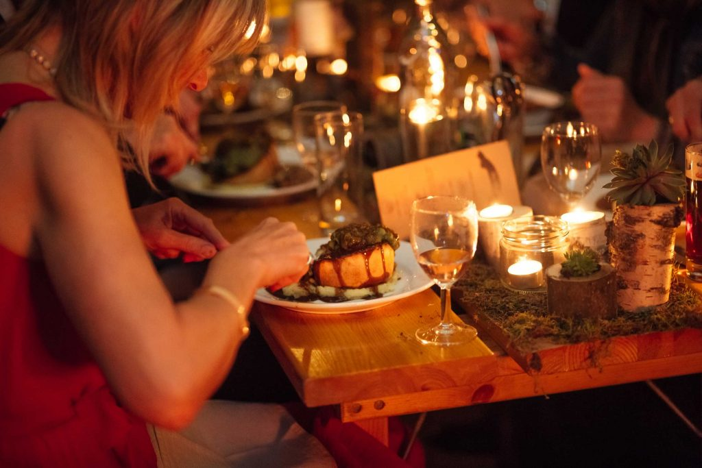 21st Birthday pie and mash meal under the atmospheric canvas of a tipi party