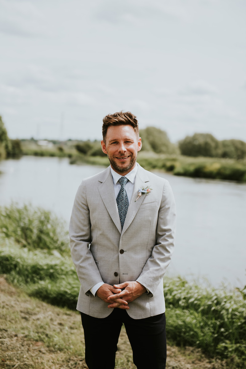 Groom wearing Paul Smith Suit ready for his outdoor ceremony. Located at Cuttle Brook, a waterfront wedding venue in Derbyshire