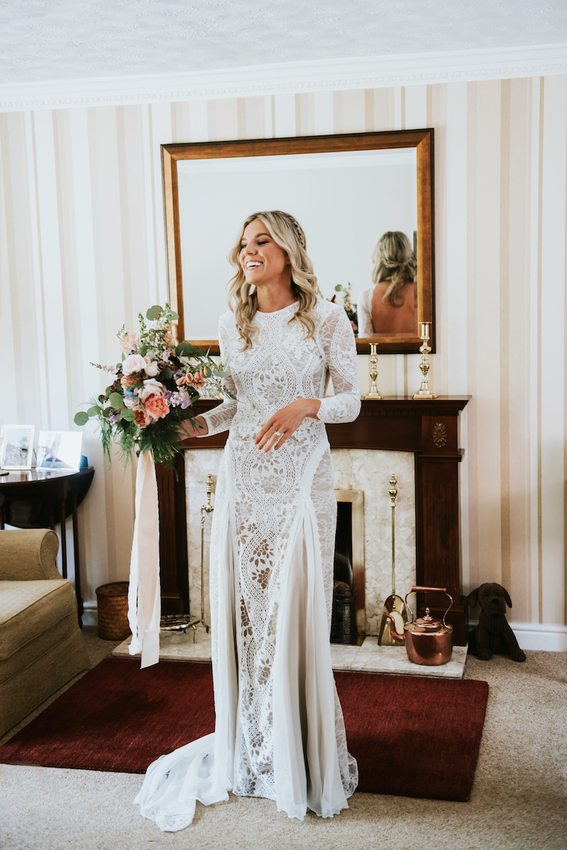 Grace Loves Lace Boho Wedding Dress complete with oversized flowers