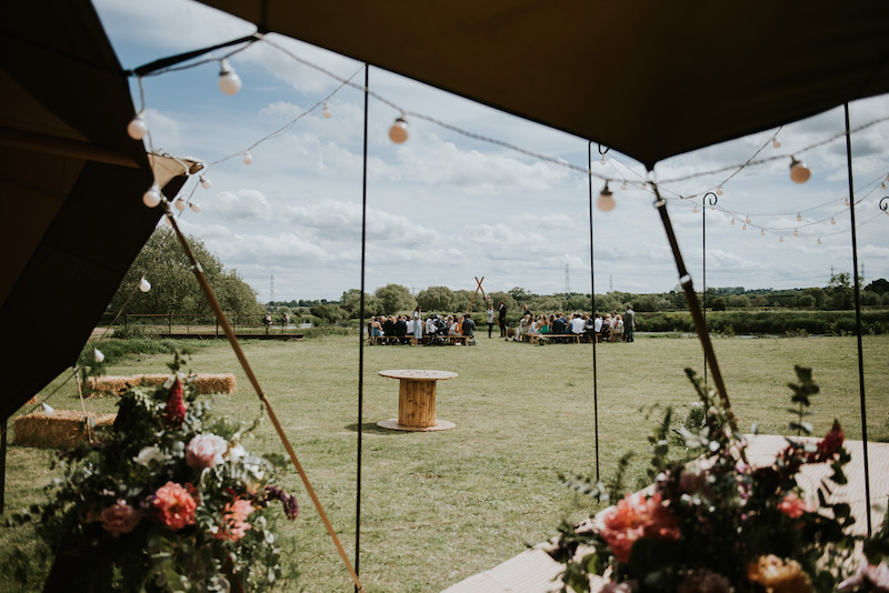view from tipis over to ceremony area and cuttle brook bridge. Cuttle Brook is a waterfront wedding venue in Derbyshire