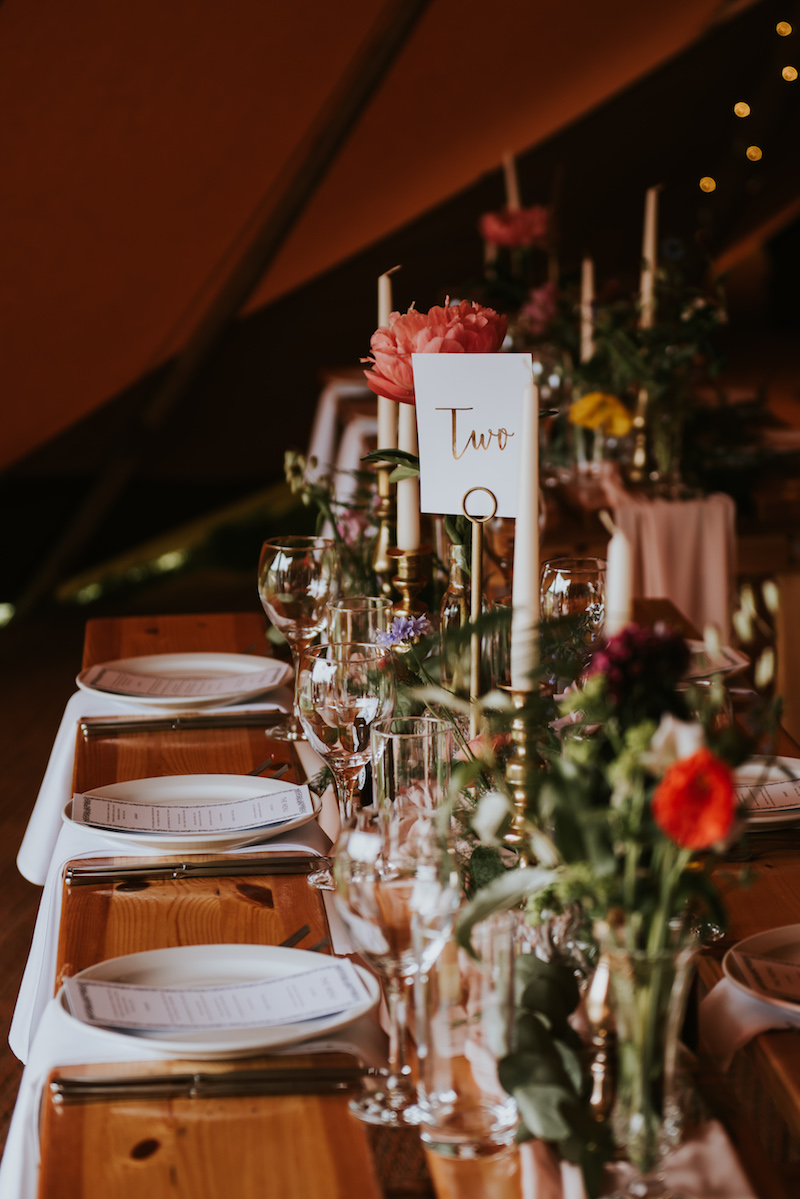 Tipi Table setup complete with candles, florals and waterfall napkins