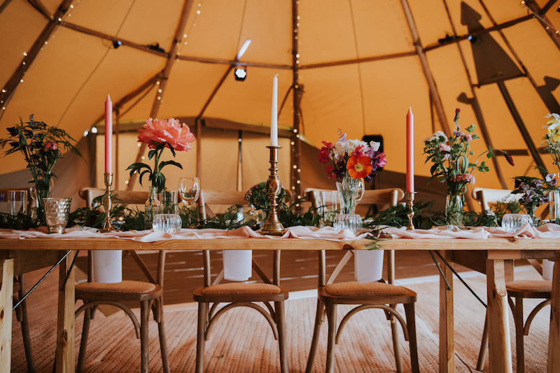 Top Table setup in front of dance floor for a sami tipi wedding