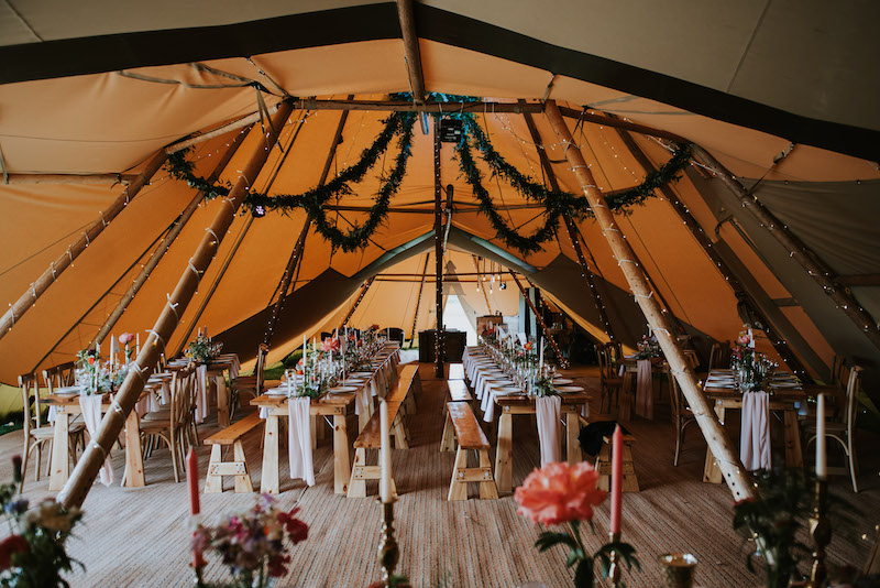 Hanging floral decoration inside a Sami Tipi