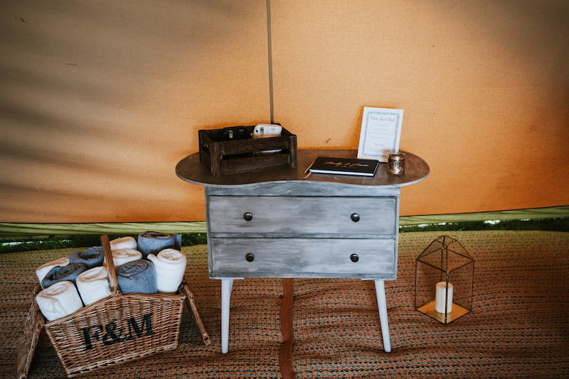 guest book and snuggle blankets add a special touch for your outdoor tipi wedding