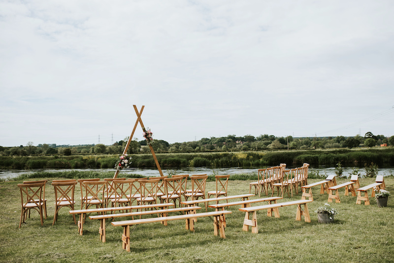 Waterfront Wedding Venue, Cuttle Brook, with ceremony area setup with chairs and benches overlooking the River Trent
