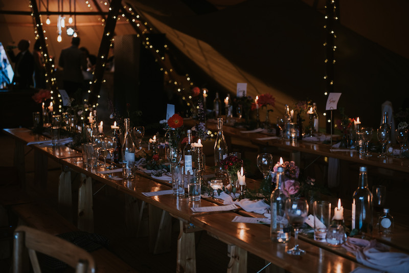 table decorations night time showing off fairy lights in Tipi