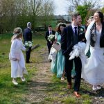 Spring Tipi Wedding Bride and Groom walk to the tipis