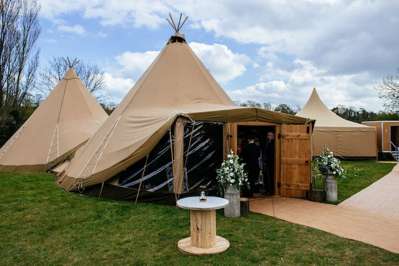 Spring Tipi Wedding Three giant hat tipis with wooden doors and clear frontage